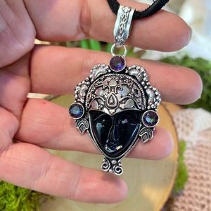 Mystic Topaz carved gemstone face silver pendant